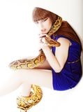 Woman in blue dress with Python Stock Photos