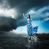 Woman in Blue Dress Reaching for the Light Stock Photos