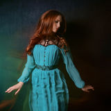 Woman in a blue dress. With red hair Royalty Free Stock Photos