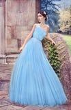 Woman in blue dress, in the secret garden stock image