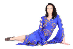 Woman in blue dress sitting Stock Image