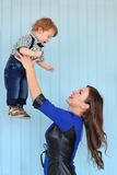 Woman in blue dress throws up little son Royalty Free Stock Images