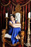 Woman in a blue dress and tiara Stock Image