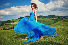 Woman in blue dress on Tuscany hills Royalty Free Stock Images
