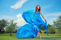 Woman in blue dress on Tuscany hills Royalty Free Stock Photography