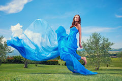 Woman in blue dress on Tuscany hills Royalty Free Stock Photo