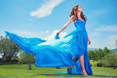 Woman in blue dress on Tuscany hills Stock Images