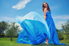 Woman in blue dress on Tuscany hills Stock Photo