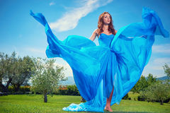 Woman in blue dress on Tuscany hills Stock Photography