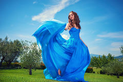 Woman in blue dress on Tuscany hills Royalty Free Stock Photos