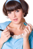 Woman in blue dress with two make-up brushes Royalty Free Stock Image