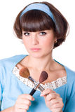 Woman in blue dress with two make-up brushes Stock Photo