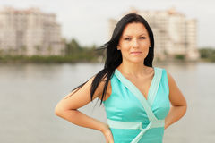 Woman in a blue dress by the water Royalty Free Stock Image