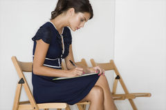 Woman In Blue Dress Writing Stock Images