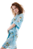 Woman in blue dressing-gown Royalty Free Stock Photography