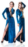 Woman in blue evening dress royalty free stock image