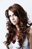 Woman with blue eyes and long curly hair Royalty Free Stock Images