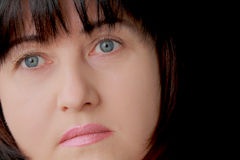 Woman with blue eyes. Portrait of woman with blue eyes and black hair Stock Images