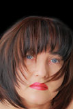 Woman with blue eyes. Portrait of woman with blue eyes and black hair Royalty Free Stock Images