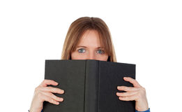 Woman with blue eyes reading a book Stock Images