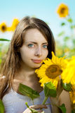 Woman with blue eyes with sunflowers stock image