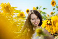 Woman with blue eyes with sunflowers Stock Images