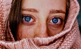 Woman With Blue Eyes Wrapped in a Pink Cloth stock images