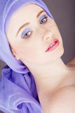 Woman with blue fabric wrapped around head Royalty Free Stock Images