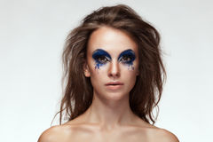 Woman with blue fantasy make up on eyes Stock Photography