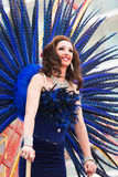 Woman in blue feathers at Gay pride parade Royalty Free Stock Image
