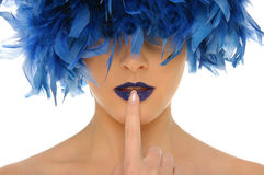 Woman with blue feathers lips and closed eyes Royalty Free Stock Image
