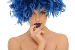 Woman in blue feathers with open eyes Royalty Free Stock Photography