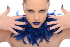 Woman with blue fingernails and blue feathers Stock Photo
