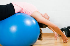 Woman and blue fitness ball Stock Photo