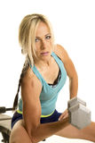 Woman in blue fitness tank top isolation curl looking Stock Photography