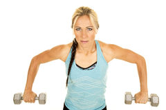 Woman in a blue fitness tank top lean forward weights down Royalty Free Stock Photo