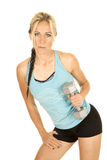 Woman in a blue fitness tank top lean to side look Stock Image