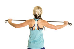 Woman in blue fitness top with band back straight Royalty Free Stock Image