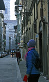 Woman in Blue in Florence, Italy. December 10, 2016.  A woman in blue braves the chilly air to shop for Christmas souvenirs in Florence, Italy Royalty Free Stock Photography