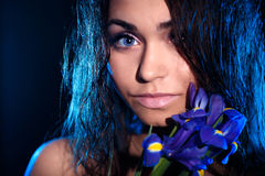 Woman with a blue flower of iris royalty free stock image