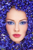 Woman in blue flowers Royalty Free Stock Photo