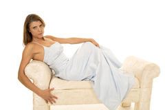 Woman in a blue formal laying on a couch head up Royalty Free Stock Photography