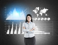 Woman in blue and four graphs on blackboard Stock Photos
