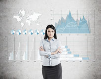 Woman in blue and four graphs on concrete Stock Image