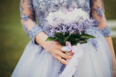 Woman in Blue Gown Holding Bouquet of Flowers Royalty Free Stock Photo