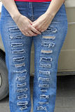 Woman in blue grunge jeans standing near auto Royalty Free Stock Photography