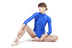 Woman in blue gymnastic leotard. Posing on a white background Royalty Free Stock Image