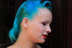 Woman with blue hair royalty free stock photography