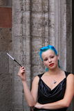 Woman with blue hair cigarette leather dress royalty free stock images