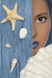 Woman with blue hair, shells, looking at camera Stock Photography